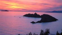 Sunset over lighthouse Grebeni, seen from the shore, copyright Yvonne Gordon