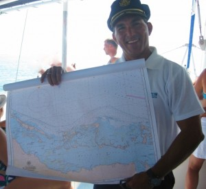 The skipper plots the course for sailing in Cuba, by Yvonne Gordon